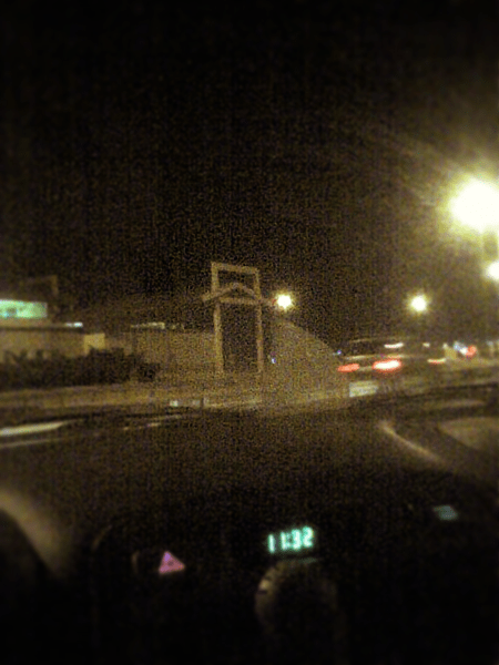 A camera phone picture from 2008 when I went to pick E up at the airport late one night. Notice the time on the clock.
