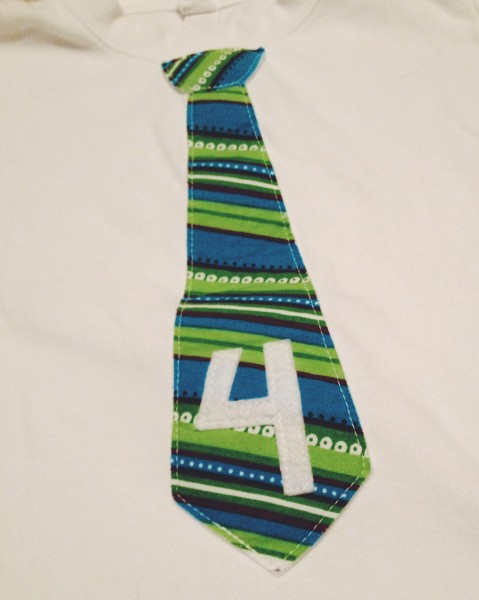 B's birthday tie shirt. How do we have 4 of these already?
